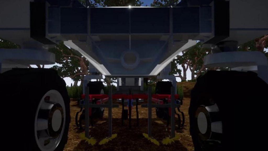 Description : Gros plan sur les roues et les mécanismes d'un tracteur robot robotisation